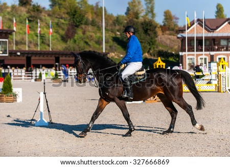 KYIV, UKRAINE - OCTOBER 10, 2015: A participant of competitions in jumping demonstration during international equestrian tournament