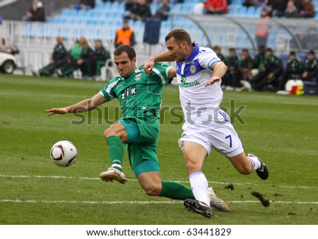 KYIV, UKRAINE - OCTOBER 16, 2010: Andriy Shevchenko of Dynamo Kyiv (R) fights for the ball with Ivan Milosevic of Karpaty Lviv during their Ukraine Championship on October 16, 2010 in Kyiv, Ukraine - stock photo