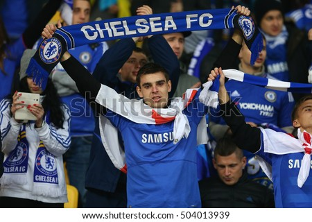KYIV, UKRAINE - OCTOBER 20, 2015: Chelsea fan portrait with scarf in hands, UEFA Chamions League Group Stage match between Dynamo Kyiv and Chelsea