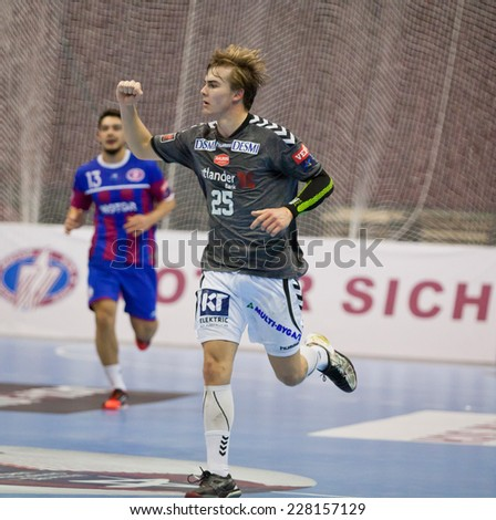 KYIV, UKRAINE - OCTOBER 18, 2014: Christian Jensen of Aalborg reacts after scored against Motor during their European Handball Champions League game - stock photo