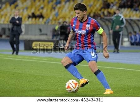 KYIV, UKRAINE - OCTOBER 2, 2014: Cristian Tanase pictured in action during the UEFA Europa League game between Dynamo Kyiv and Steaua Bucharest on Olimpiyskiy Stadium. - stock photo