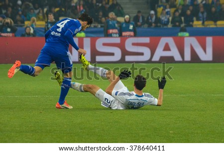 KYIV, UKRAINE - October 20, 2015: Danilo Silva of Dynamo Kyiv (L) fights for a ball with Cesk Fabregas of FC Chelsea during their UEFA Champions League game at NSC Olimpiyskyi stadium