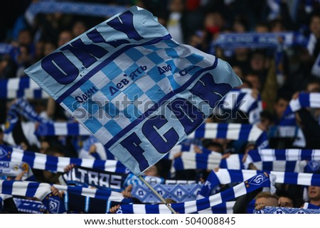 KYIV, UKRAINE - OCTOBER 20, 2015: Dynamo fans with many scarfs close-up and waving flag, UEFA Chamions League Group Stage match between Dynamo Kyiv and Chelsea