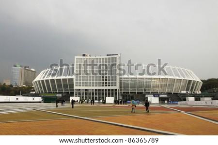 KYIV, UKRAINE - OCTOBER 8: Visitors enter the Olympic stadium (NSC Olimpiysky), the main stadium of Euro-2012 football championship, on the day of grand opening (after reconstruction) on October 8, 2011 in Kyiv, Ukraine - stock photo