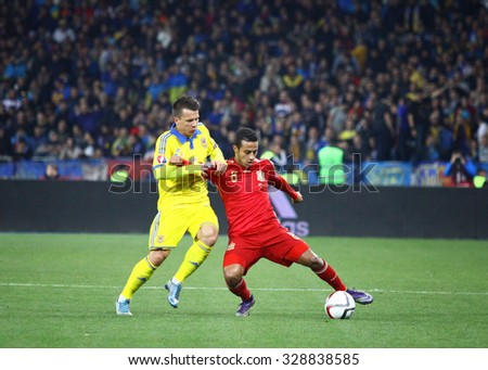 KYIV, UKRAINE - OCTOBER 12, 2015: Yevhen Konoplyanka of Ukraine (L) fights for a ball with Thiago Alcantara of Spain during their UEFA EURO 2016 Qualifying game at NSK Olimpiyskyi stadium - stock photo