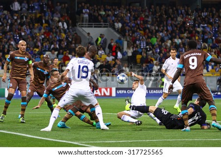 KYIV, UKRAINE - SEPTEMBER 16, 2015: FC Dynamo Kyiv (in White) and FC Porto (in Brown) players fight for a ball during their UEFA Champions League game at NSC Olimpiyskyi stadium - stock photo