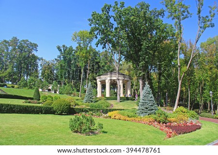 "KYIV, UKRAINE - SEPTEMBER 14, 2014: Mezhyhirya - former private residence of ex-president Yanukovich, now open to the public, Kyiv region, Ukraine. Park near building ""Honka"""