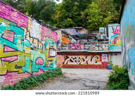 KYIV, UKRAINE - SEPTEMBER 29: Street art graffiti on abandoned buildings of the city, September 29, 2014 in Kyiv, Ukraine. - stock photo