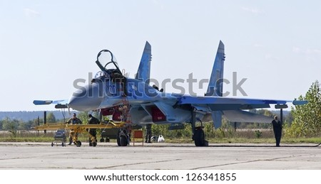KYIV, UKRAINE - SEPTEMBER 29: Undefined people and Ukrainian Air Force Su-27 during 8th International Aviation Salon AVIASVIT-XXI;Septem ber 29, 2012 in Kyiv, Ukraine - stock photo