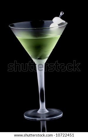Kyoto cocktail in chilled martini glass over black background on reflection surface. Green color, gin, dry vermouth, melon liqueur,  garnished with marinated pearl onions. Most popular cocktails.