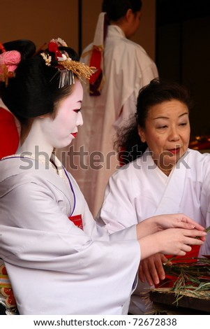 KYOTO - JAN 11:Unidentified geisha participates on a traditional New Year ceremony held on January 11 2010 in Gion district, Kyoto, Japan .The ceremony takes in an ancient Shinto Temple. - stock photo