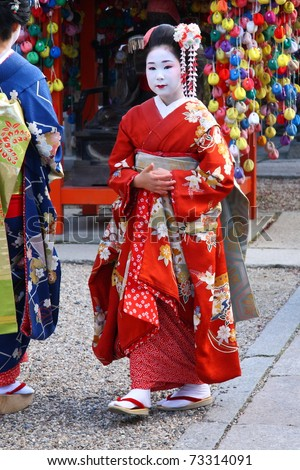 KYOTO - JAN 16: Unidentified geishas visiting a shinto temple on January 16, 2010 in Gion district, Kyoto, Japan. Geishas are skilled in traditional arts such as music, dance, singing and tea ceremony. - stock photo