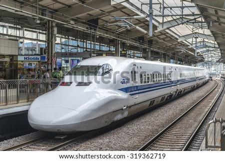 KYOTO, JAPAN - AUGUST 12: JR700 shinkansen bullet train departing Kyoto station shown on August 12, 2015 in Kyoto, Japan - stock photo