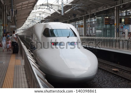 KYOTO, JAPAN - AUGUST 14: Shinkansen train waits for departure ar rail terminal in Japan on August 14, 2012. Shinkansen is a network of high-speed railway lines in Japan connecting whole country. - stock photo