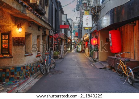 KYOTO, JAPAN - DECEMBER 25: A charming, typical narrow street in the Pontocho area of downtown Kyoto, Japan at dusk on the evening of December 25, 2011. - stock photo