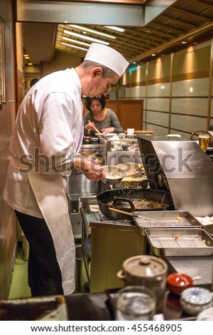Kyoto, Japan - February 23, 2014 - A japanese chef cooking tempura in front of the customers in a restaurant in Kyoto, Japan