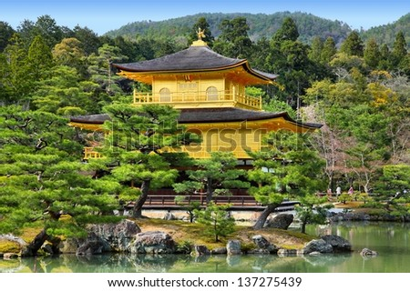 Kyoto, Japan - Golden Pavillion shariden at famous Kinkakuji (Kinkaku-ji) Temple. Buddhist zen temple of Rinzai school. - stock photo