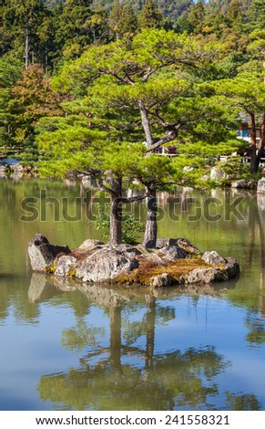 Kyoto, Japan - Japanese garden at famous Kinkakuji (Kinkaku-ji) Temple. Buddhist zen temple of Rinzai school. - stock photo