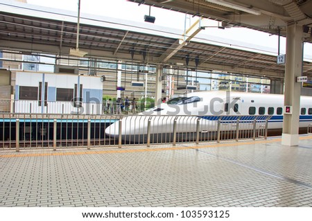 KYOTO,JAPAN-JULY 18:Bullet train at station platform on July 18,2011 in Kyoto,Japan.The railway network has connections with the cities of Tokyo, Osaka, Nara, Nagano and Kanazawa. - stock photo