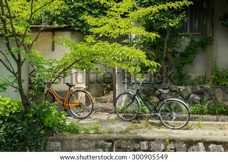 KYOTO, JAPAN - JULY 14, 2015: Parked bicycles in the � Philosopher's walk.