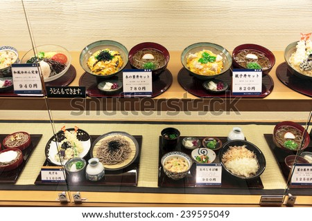 Kyoto, Japan - June 24, 2010: Plastic models of various dishes in a restaurant window on  June 24, 2010. Most street bars and restaurants in Japan exhibit their menu in the form of plastic models. - stock photo