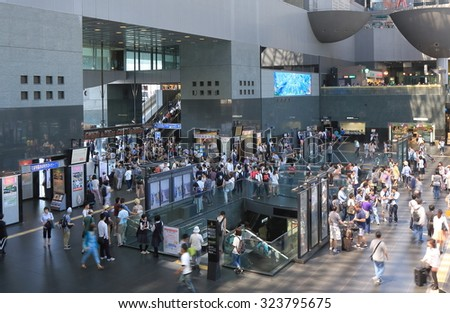 KYOTO JAPAN - 1 JUNE, 2014: Unidentified people commute at Kyoto Train station. Kyoto has a population for 1.5 million and nicknamed as the City of Ten Thousand Shrines.   - stock photo