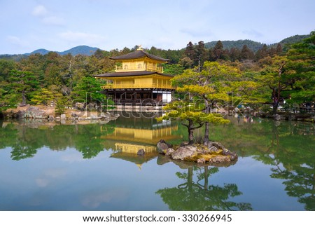 Kyoto, Japan - March 18, 2015 : Pavilion view of famous Kinkaku-ji Temple in Kyoto, Japan. The temple was founded in year 1397 (UNESCO World Heritage site).