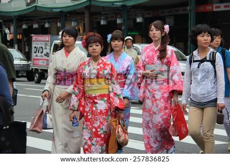 Kyoto, Japan - May 27, 2013: Unidentified Japanese women wear Kimono, beautiful Japanese traditional garment, walking in Gion area, Kyoto, Japan. - stock photo