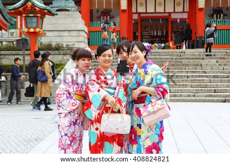 KYOTO, JAPAN - Nov 3: Tourists walk visits to Fushimi Inari taisha shrine on November 3, 2015 in Kyoto, Japan. Including trails up the mountain to many smaller shrines which span 4 kilometers - stock photo
