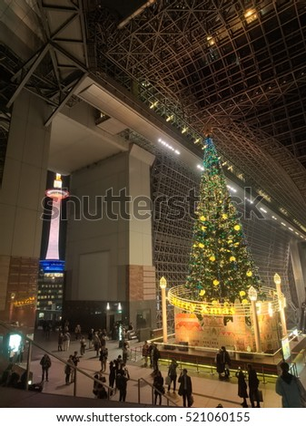 KYOTO, JAPAN - NOVEMBER 18, 2016:  A competition between a decorated christmas tree of 22 meters tall and illuminated Kyoto Tower of 131 meters tall at Kyoto Station, Japan on November 18, 2016.