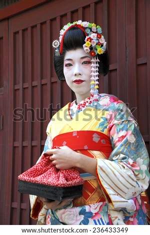 KYOTO,JAPAN - NOVEMBER 4, 2014: Geisha woman in traditional dress. Kyoto is center of Japan's traditional culture. Kyoto is the capital of the geisha world.  November 4, 2014 Kyoto, Japan. - stock photo