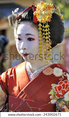 KYOTO,JAPAN - NOVEMBER 4, 2014: Geisha woman in traditional dress. Kyoto is center of Japan's traditional geisha culture. They are called 'maiko' in Kyoto. November 4, 2014 Kyoto, Japan. - stock photo