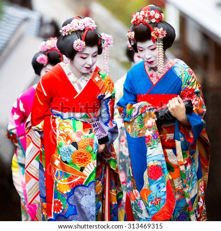 KYOTO, JAPAN - NOVEMBER 20: Maiko in Kyoto, Japan on November 20, 2014. Apprentice geisha in western Japan, especially Kyoto. Their jobs consist of performing songs, dances, and playing the shamisen