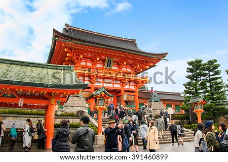 KYOTO, JAPAN- NOVEMBER 02: Many unidentified tourists visit Fushimi Inari Shrine and take a photo at Torii gate in Kyoto, Japan on NOVEMBER 02, 2015