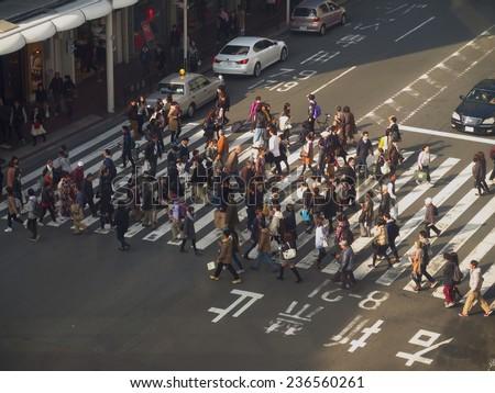 KYOTO, JAPAN - NOVEMBER 24 : People crossing street at Kawaramachi area taken November 24, 2014 in Kyoto. Kawaramachi is the modern area with many department stores in Kyoto. - stock photo