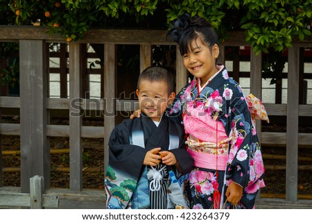 KYOTO, JAPAN - NOVEMBER 22 2015: Shichi-go-san, a traditional rite of passage and festival day in Japan for 3 and 7-year-old girls and 3 and 5-year-old boys at Heian-jingu Shrine - stock photo