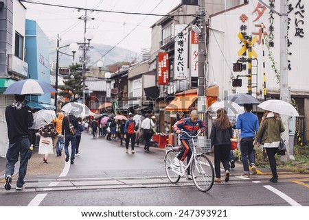 KYOTO, JAPAN - NOVEMBER 11: Tourists walking on Street to Fushimi Inari  on November 11, 2014 in Kyoto, Japan. Old Kyoto is a UNESCO World Heritage site