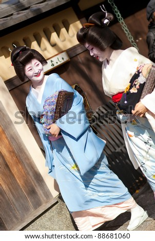 KYOTO, JAPAN - NOVEMBER 8: Two Geishas attending the annual Kanikakni festival in Gion, Kyoto on the 8th of November, 2011 - stock photo