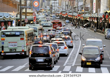 KYOTO,JAPAN-NOVEMBER 3, 2014; Typical view of busy street in central of the town at twilight. November 3, 2014 Kyoto, Japan. - stock photo
