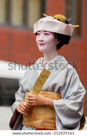 """KYOTO, JAPAN - OCTOBER 22: Jidai Matsuri in Kyoto, Japan on October 22, 2014. Participants at the """"Historical Parade"""", one of Kyoto's renowned three great festivals held on 22nd October annually - stock photo"""