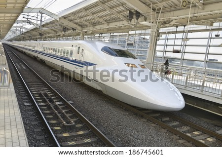 KYOTO, JAPAN - OCTOBER 23: On train station on October 12, 2012 in Kyoto, Japan. Here you can take the Shinkansen bullet train that goes at incredible speeds of up to 320 km/h (200 mph) - stock photo