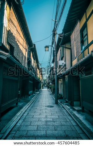 Kyoto - July 2016: Narrow lane with traditional Japanese houses at Gion - stock photo