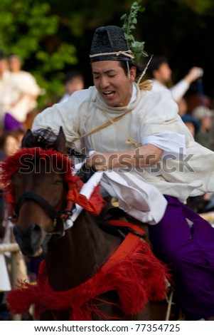 KYOTO - MAY 15: Running Horse ceremony on The Aoi Matsuri (Hollyhock Festival) held on May 15 2011 in Kyoto, Japan . It is one of Kyoto's renowned three great festivals