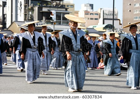 KYOTO - OCT 22: Participants at The Jidai Matsuri (Festival of the Ages) held on October 22, 2009 in Kyoto, Japan. It is one of Kyoto's renowned three great festivals. Meiji period. - stock photo