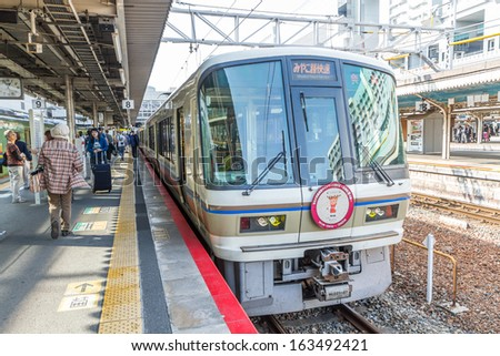 KYOTO - OCT30, 2013: Travelers train at Kyoto railway station  in October 30, 2013 Kyoto, Japan.