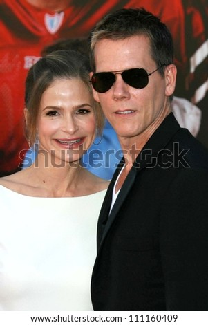 """Kyra Sedgwick and Kevin Bacon at the world premiere of """"The Game Plan"""". El Capitan Theater, Hollywood, CA. 09-23-07 - stock photo"""