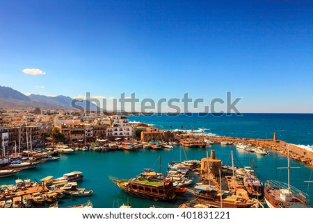 KYRENIA, CYPRUS - OCTOBER 6, 2013: Historic harbour and the old town in Kyrenia (Girne) on the Island of Cyprus. - stock photo