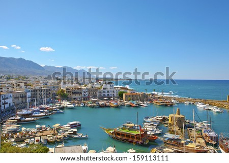 KYRENIA, CYPRUS - OCTOBER 6 - Scenic view of a busy historic harbour and the old town in Kyrenia (Girne) on the Island of Cyprus, October 6, 2013. - stock photo