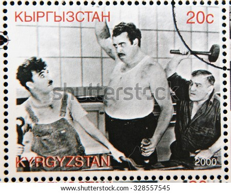 "KYRGYZSTAN - CIRCA 2000: A stamp printed in Kyrgyzstan shows scene from the movie ""Modern Times"" by Charles Chaplin, circa 2000  - stock photo"