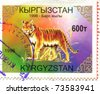 KYRGYZSTAN - CIRCA 1998: stamp printed by Kyrgyzstan, shows  tiger, circa 1998. - stock photo